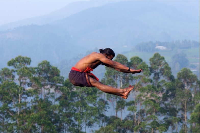 A martial artist leaps in the air.