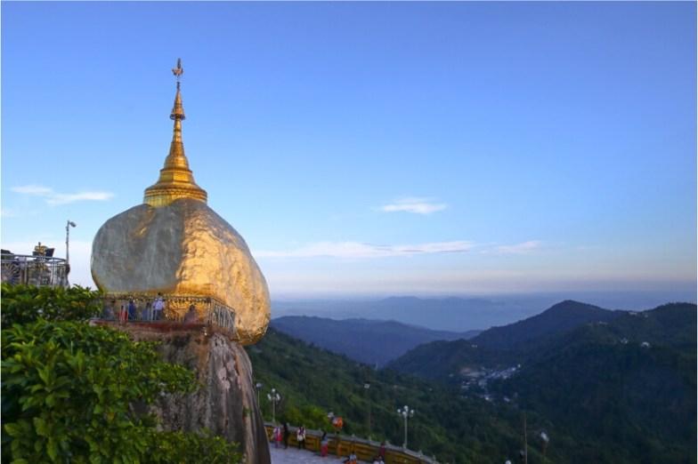 Golden Rock, a huge gold-covered boulder perched on a cliff side in Myanmar.