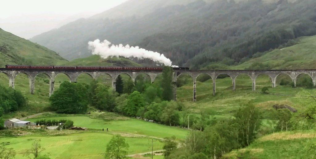 Harry Potter train crossing Glenfinnan Viaduct, Scotland