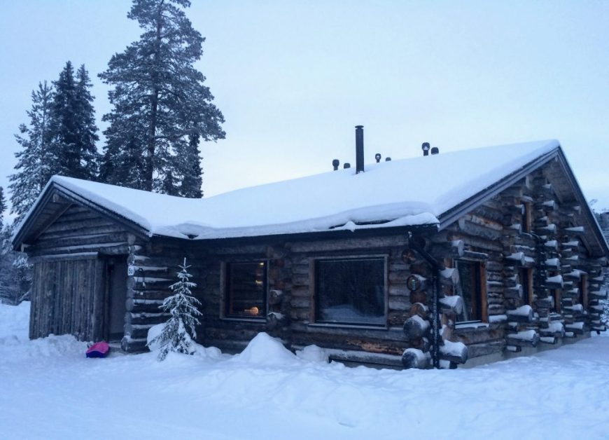 Log cabin in winter