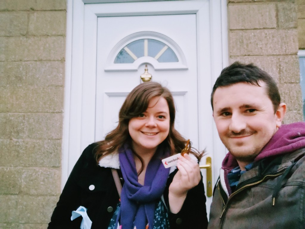 Scott and Justine outside their first house purchase