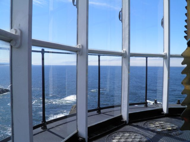 On top, inside the Yaquina Head Lighthouse