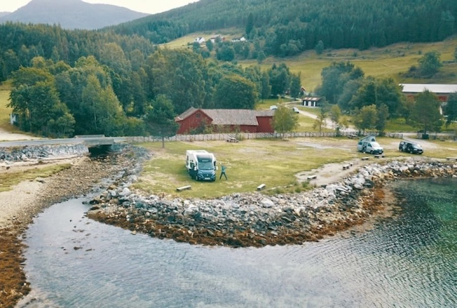 Is this the best campsite in Norway? Just look at those views! This post tells you exactly where this magic spot is and how to get there! #campsite #norway #roadtrip #motorhome #rv #travel #adventure