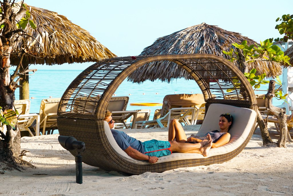 Chilling in one of the couples beach chairs at Sandals Montego bay, a luxury all inclusive vacation experience