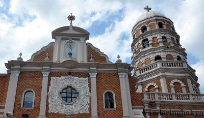 At the top of the façade is an image of Our Lady of Pillars