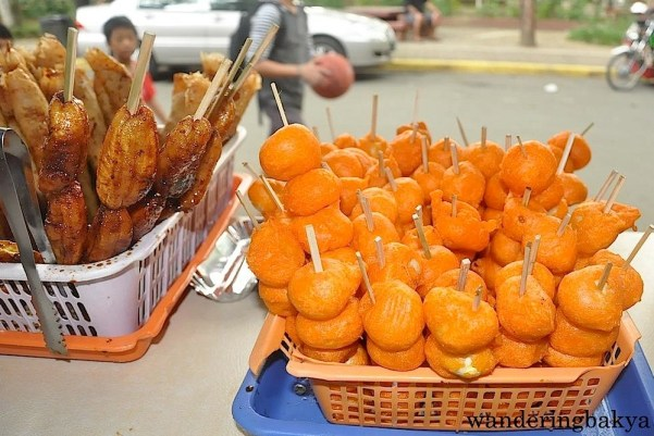 Banana fritter, one stick is P12.00 (0.27) and kwek-kwek or quail eggs in batter fried to look like golden eggs, 5 pieces cost P15.00 (US $0.33)