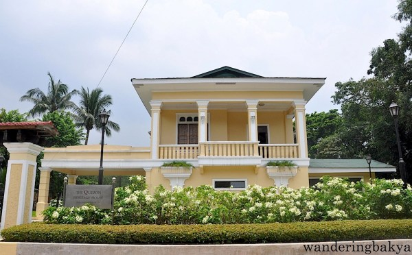 The façade of Quezon Heritage House. Sixty percent of the house is from the original house that used to be located in Gilmore, San Juan. The flowers that line the front are symbolic. The green and red flower is called Don Manuel while the tall green and white flower is called Doña Aurora. The Don Manuel flowers surround the Doña Aurora flowers so show that Don Manuel is the protector of his wife.