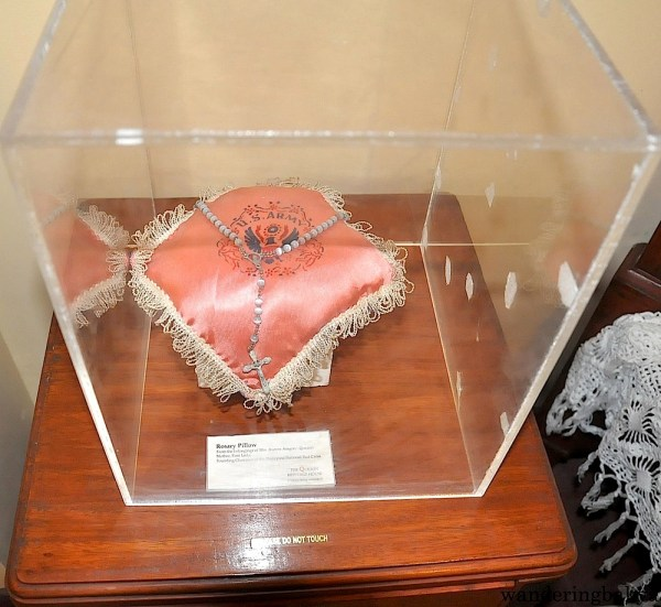 The rosary pillow holds the rosary beads that were found near the body of Doña Aurora after they were ambushed by what the authorities believe to be members of the Hukablahap. Hukbalahap was a guerilla movement that persevered even after World War II.