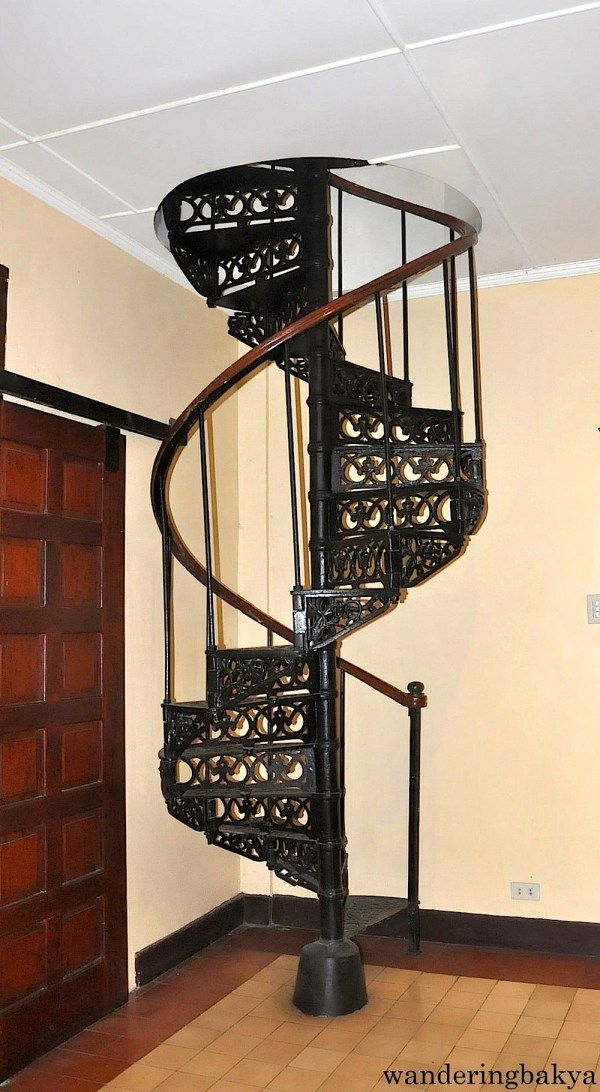 The top view of the spiral staircase that leads to the ground floor and the same staircase as seen from the ground floor. I may be wrong, but if I recall correctly the staircase is 115 years old.