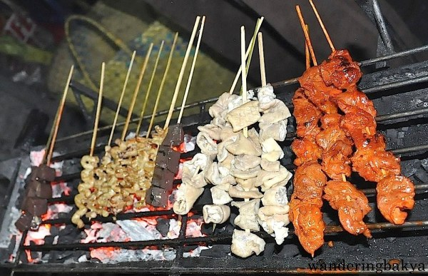 Choose your poison and the vendor will grill it in front of you. Just do not stay too close to the grill because the grilled food has a certain distinct smell that stays with sticks to your hair and clothes.