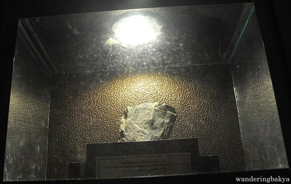 Found in the church basement is this stone from a place where Virgin Mary had an apparition.
