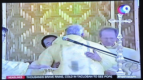 Pope Francis hugged the people around him during the Sign of Peace