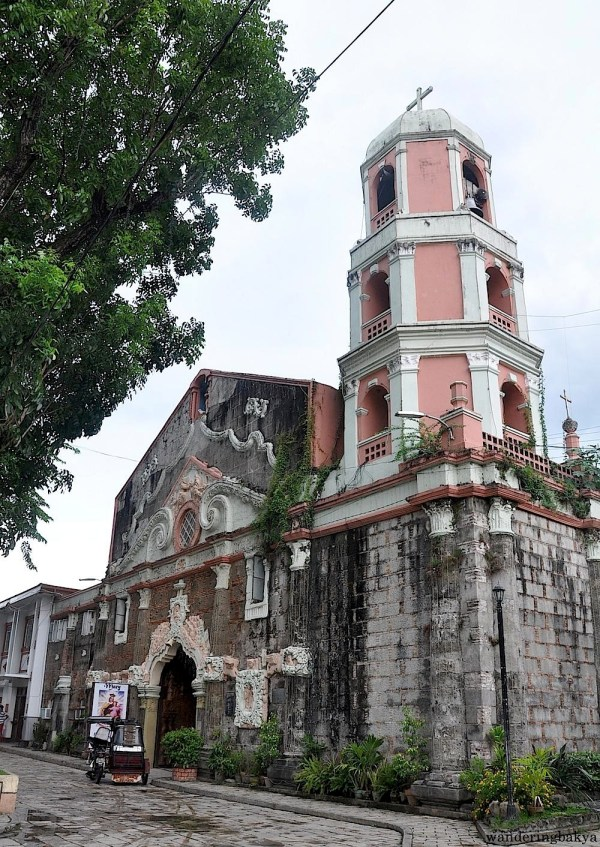 Another look at St. John the Baptist Church. The vehicle in front of the church is a tricycle, one of the more common modes of transportation in the Philippines.