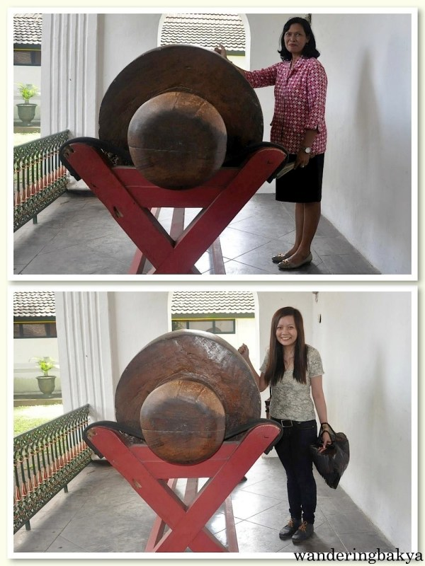 This is the fire alarm. It is carved out of a jackfruit tree. Our tour guide (above) showed me how to use it.