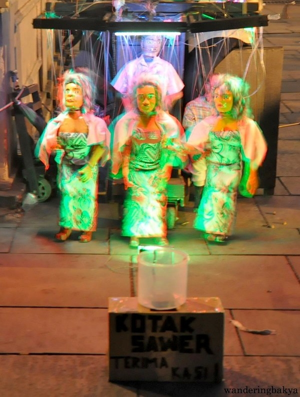 These marionettes (?) danced to the music and if my memory serves me right, they also sang.  Low light and moving objects are my waterloo, just believe me that they were entertaining even if the photo does not make it appear to be one.