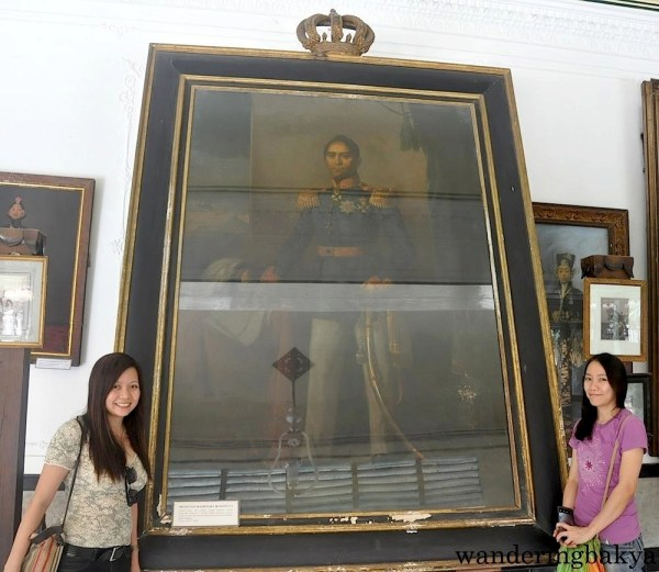 Virg and I with the image of Sri Sultan Hamengku Buwono VI. This photo is surrounded by the photos of this family members