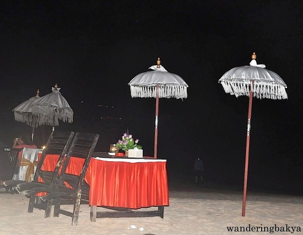 One of the dinner set-ups at Jimbaran Bay. The pitch black part is actually the water.
