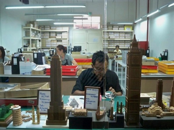 Kuala Lumpur City Gallery has workers making architectural scale models of the buildings found in KL.