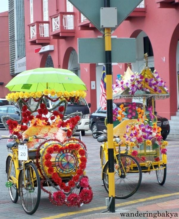 More colorful rickshaws in Dutch square