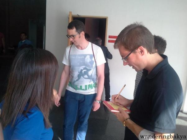 Juan Manuel writing down their website address. Photo by SPRDC.