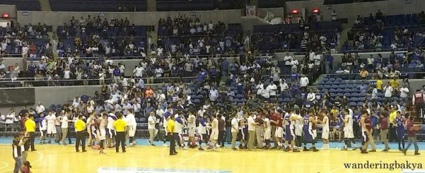 Players, coaches and staff of Ateneo Blue Eagles and UP Fighting Maroons after the game.