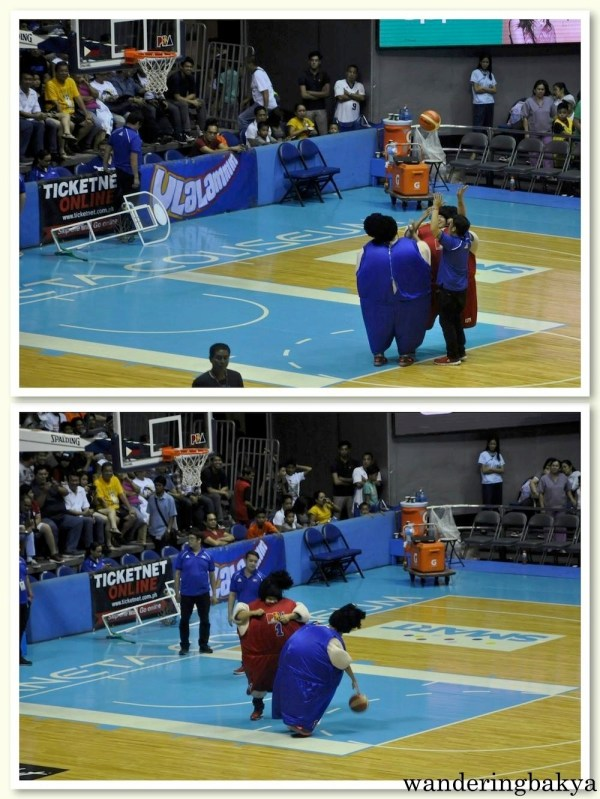Two contestants in fat suit try to outmaneuver each other to take a crack at the basket. Let us call this game, sumo basketball.