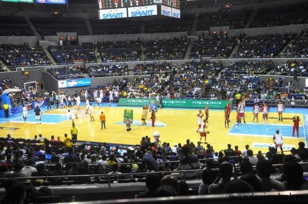Players practicing during the halftime break between Barangay Ginebra and Meralco Bolts