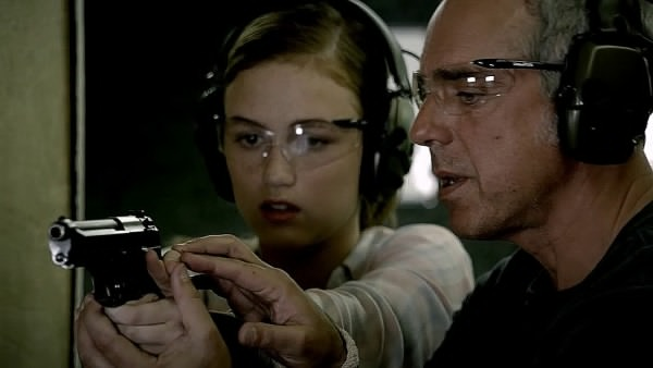 Harry Bosch (Titus Welliver) and Maddie (Madison Lintz) at a shooting range. Photo from imfdb.org