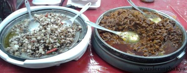 Pork sisig - chopped pig snout, ears and liver. Yum!