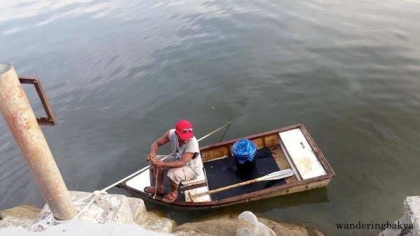 A fisherman used the rope of one of the boats to make his way to Harbour Square. Inside the pail with blue plastic cover were fish he caught in Manila Bay.