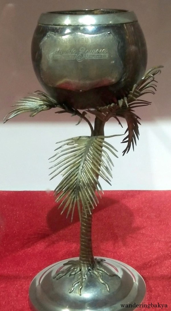 Coconut shell trophy with decorative silver-plated leaves and stand, a gift from Manileño silversmith engraver, Crispulo Zamora.