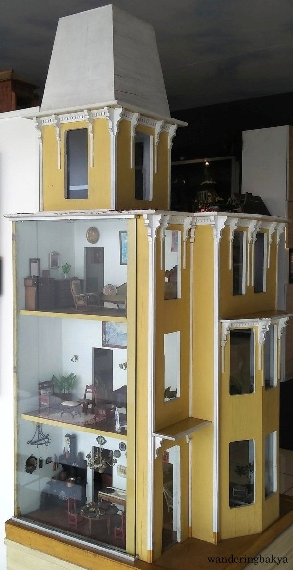 Miniature doll house and some of its contents
