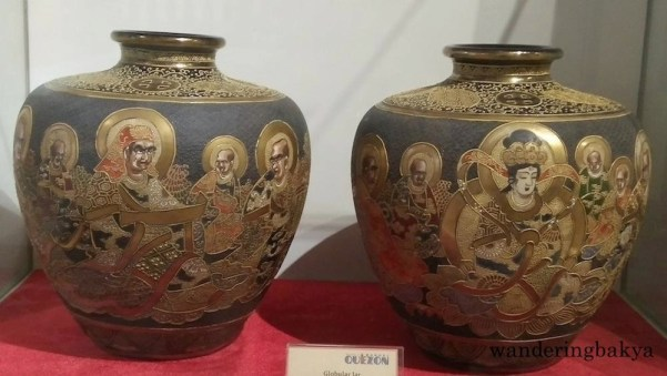 Globular jars with various Chinese deities in black and gold. They were from Chinese Consul General Kwangsen Young and Alfonso Sycip.