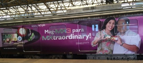 MX3 is probably the cheesiest among the LRT Line 2 train ads, but that pop of color has not failed to brighten my day when I see it. Photo by Steve.