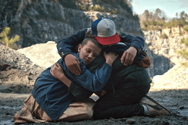 Stranger Things' Eleven or El (Millie Bobby Brown), Mike Wheeler (Finn Wolfhard) and Dustin Henderson (Gaten Matarazzo) in a group hug by the quarry. Photo from hitflix.com