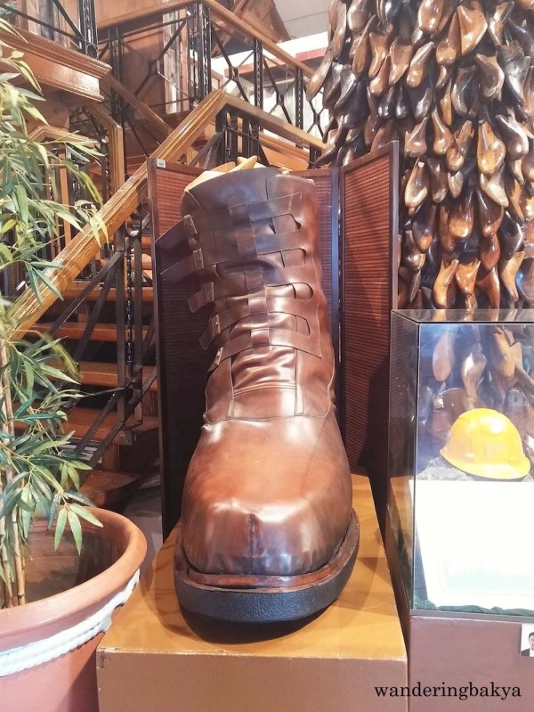 A giant boot welcomes the visitors to Shoe Museum