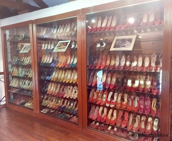 Glass cabinets full of shoes from the 3,000 pair collection of shoes owned by Mrs. Imelda Marcos