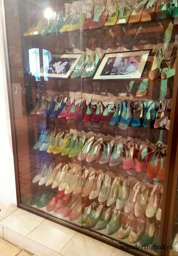 Mrs. Marcos had enough sling back shoes to fill six levels of glass cabinet.