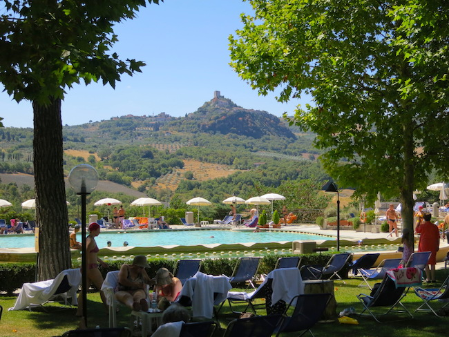 Hot springs Italy Tuscany Bagno Vignoni outdoor thermal pools with hills in the background