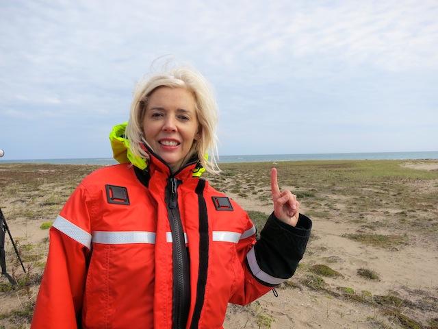 Wandering Carol on the tundra pointing to polar bear