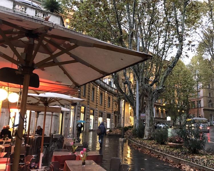 Cafe with red umbrella at Via Veneto Rome