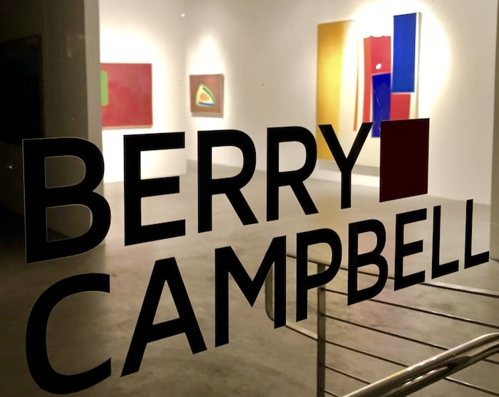 Berry Campbell Gallery sign in Chelsea New York with Perehudoff art exhibit in background