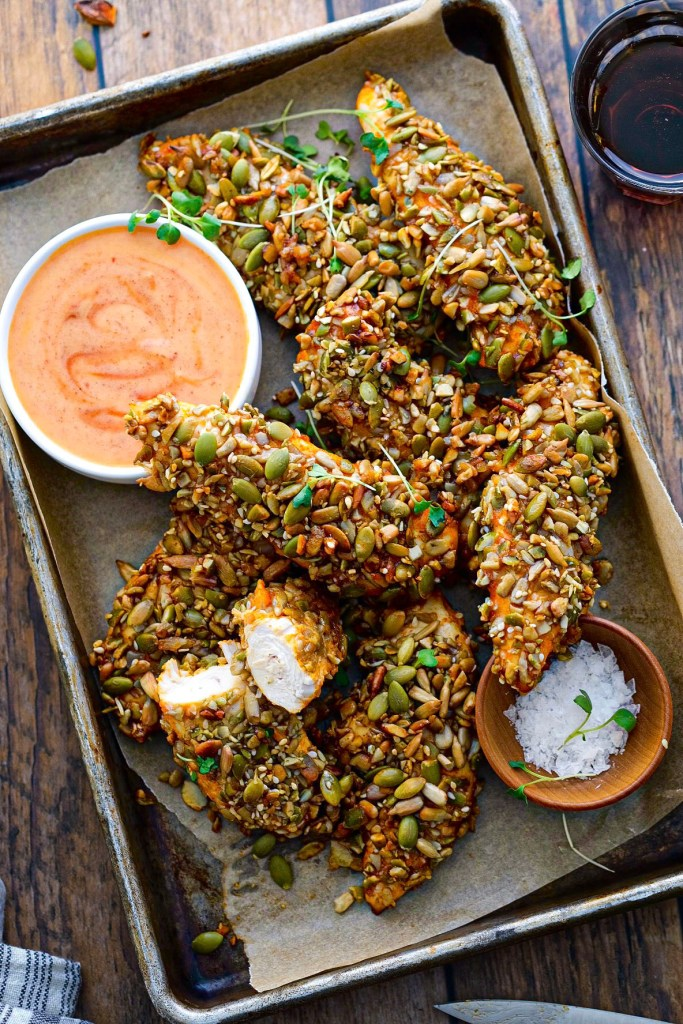 Pumpkin Seed Crusted Chicken Tenders with Maple Sriracha Dipping Sauce