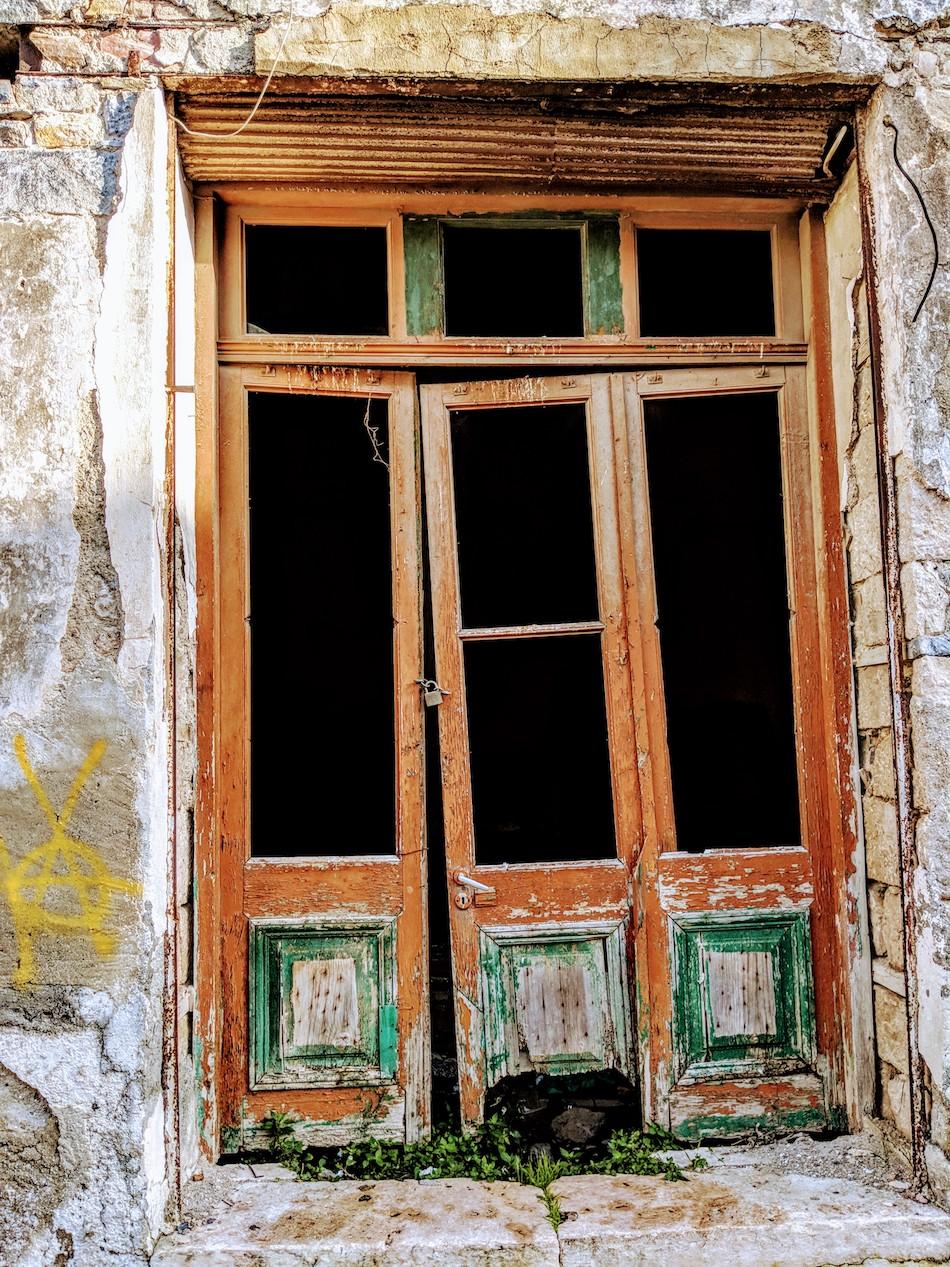 Working in Samos refugee camp in Greece with an NGO called Samos Volunteers. Old European doors on Samos, Greece.
