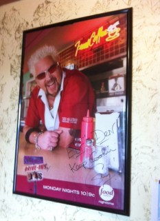 Guy Fieri's poster greets you as you enter the restaurant