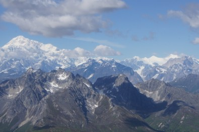 Mt. McKinley is in the upper left beneath the clouds