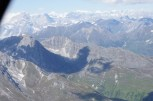 Shadow of our plane over the mountains