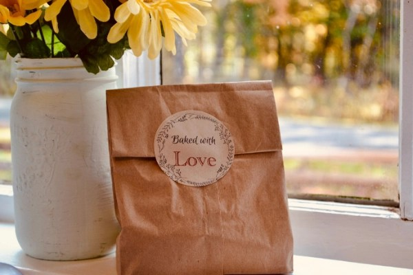 baked with love label on brown paper bag