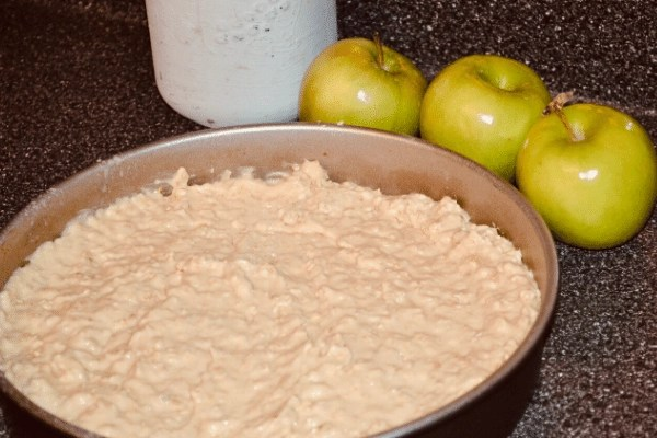 apple cake in round cake pan before adding apples