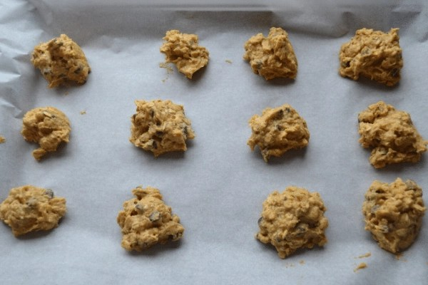 pumpkin oatmeal chocolate chip cookie dough on the cookie sheet